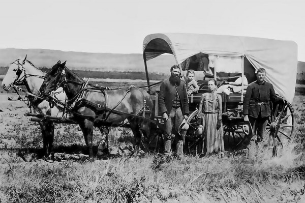 westward-family-in-covered-wagon-c-1886-daniel-hagerman.jpg
